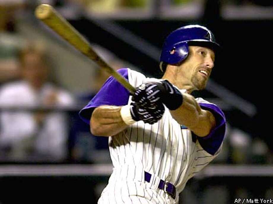 Arizona Diamondbacks slugger Luis Gonzalez watches his 50th home run leave the park against the San Francico Giants Wednesday, Aug. 29, 2001 at Bank One Ballpark in Phoenix. Gonzalez becomes the 19th MLB player all-time to reach 50 home runs in a season.(AP Photo/Matt York) Photo: MATT YORK