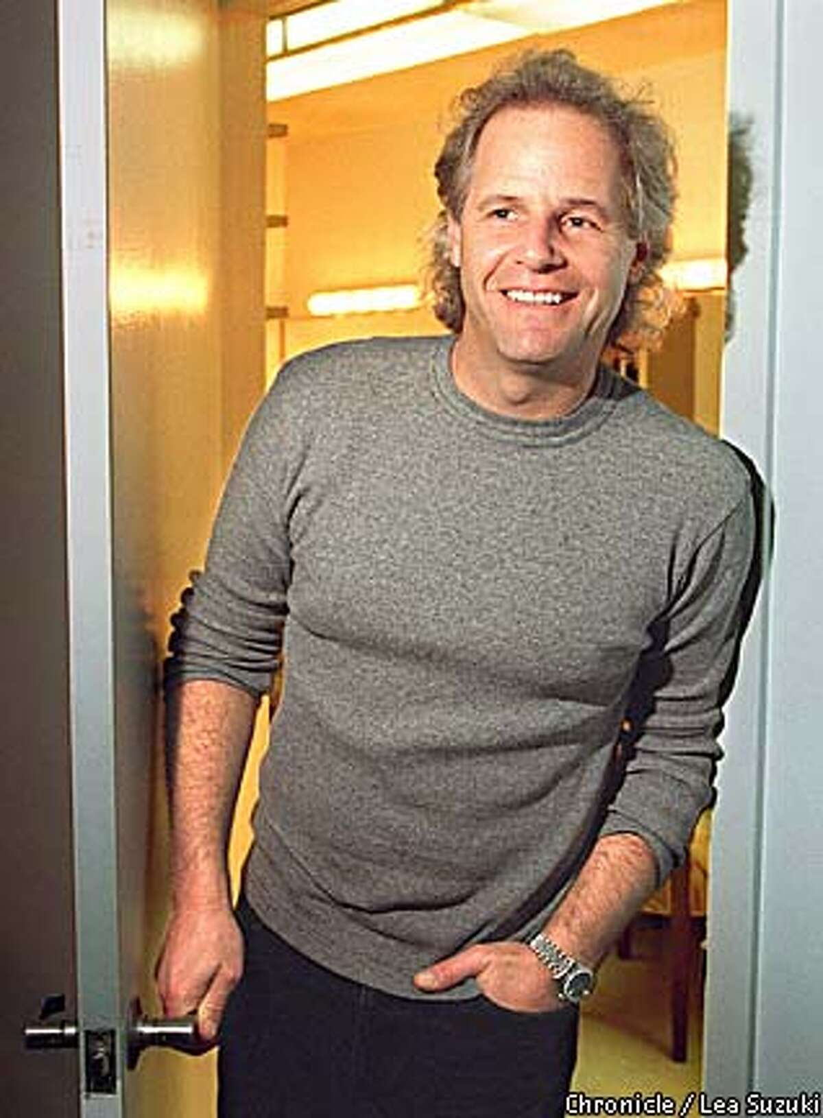 Chris Carter says he'll try to wrap up the series' many loose ends. Chronicle photo, 1996, by Lea Suzuki