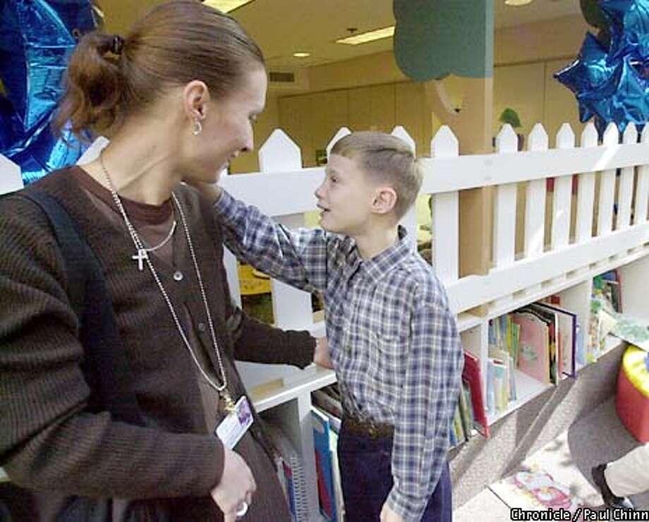 Seven-year-old Jay Ferrick said hello to hospital social worker Beatrix Lazard at UCSF Children's Hospital.  PAUL CHINN/S.F. CHRONICLE Photo: PAUL CHINN