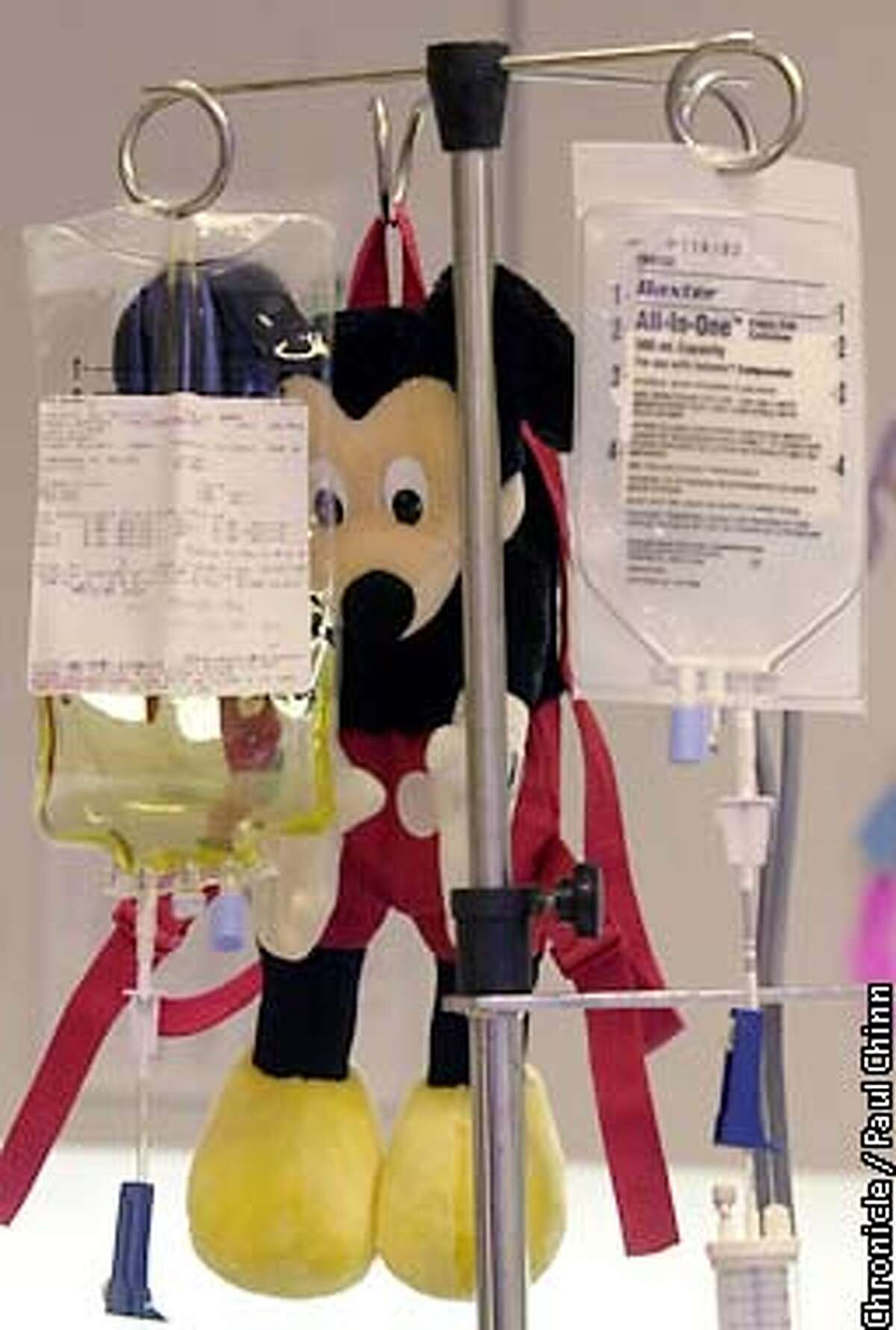 Mickey Mouse dangled next to an IV drip in the Magic Playroom of UCSF Children's Hospital. PAUL CHINN/S.F. CHRONICLE