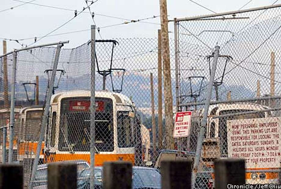 Some of the old MUNI Boeing streetcars sit unused behind fences in the streetcarbone yard on Geneva and San Jose Avenue in San Francisco on Friday afternoon. Photo by Jeff Chiu / The Chronicle. Photo: Jeff Chiu