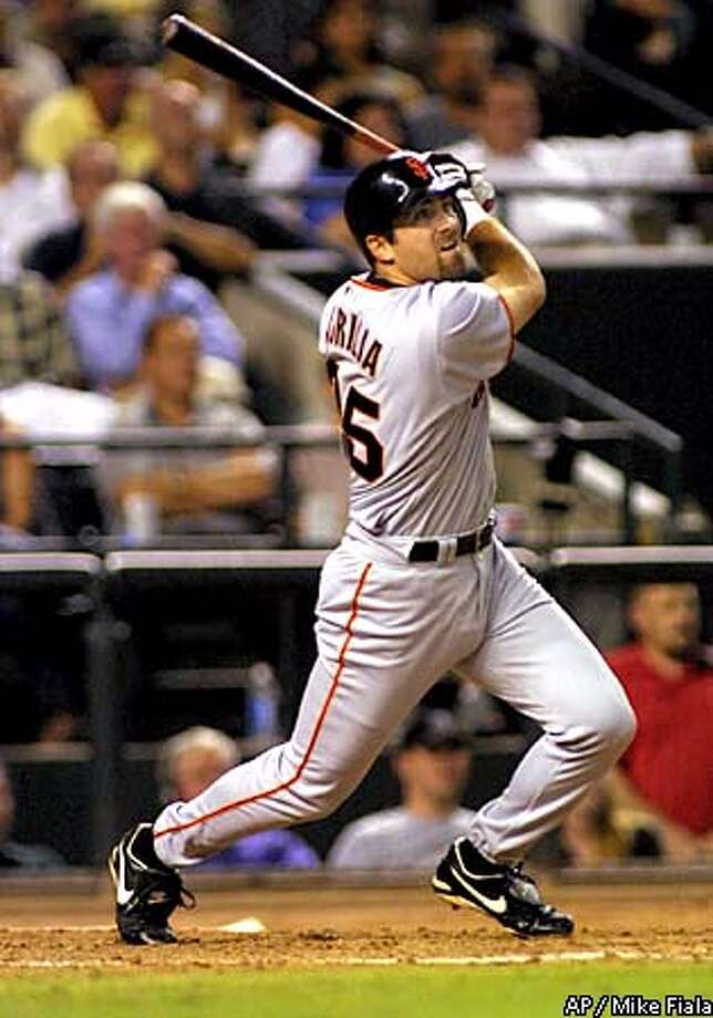 San Francisco Giants' Rich Aurilia blasts a three run home run against the Arizona Diamondbacks during the third inning Friday, Aug. 30, 2001 at Bank One Ballpark in Phoenix.(AP Photo/Mike Fiala) Photo: MIKE FIALA