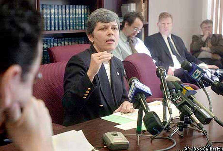 "California legislative analyst Elizabeth Hill, center, makes a point during a news conference Tuesday, Jan. 14, 2002 in Sacramento, Calif. Hill said Gov. Gray Davis' 2002-03 budget relies on ""overly optimistic"" assumptions and could cost the state billions in the coming years. (AP Photo/Robert Galbraith) Photo: ROBERT GALBRAITH"