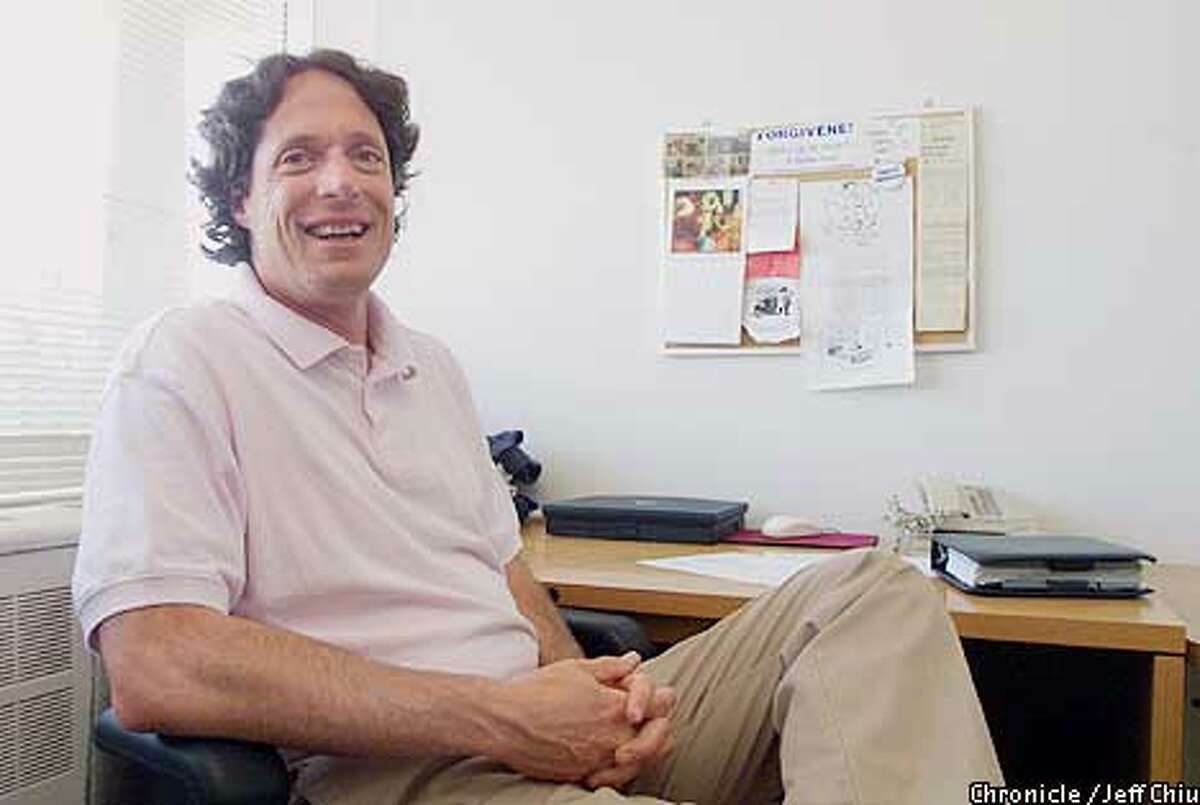 Professor Frederic Luskin, who is active in the positive psychology movement and started the Stanford Forgiveness Project, at his office at Stanford University in Palo Alto on Wednesday afternoon. Photo by Jeff Chiu / The Chronicle.