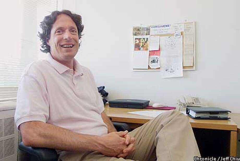 Professor Frederic Luskin, who is active in the positive psychology movement and started the Stanford Forgiveness Project, at his office at Stanford University in Palo Alto on Wednesday afternoon. Photo by Jeff Chiu / The Chronicle. Photo: Jeff Chiu