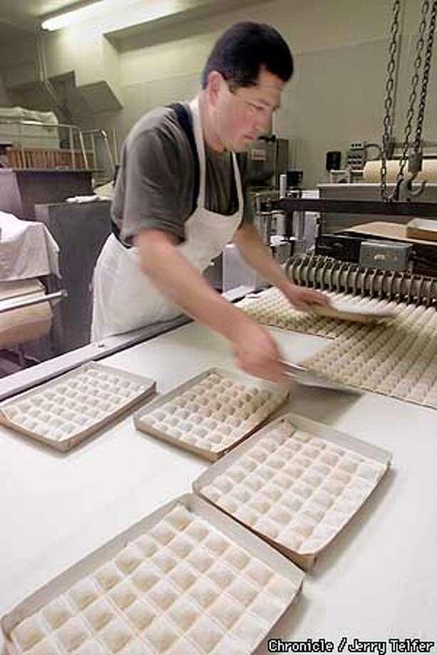 Federico Coria (dark shirt) packages ravioli during production run at Home Maid Ravioli in San Mateo, CA.  109 South Blvd. - San Mateo, CA  CHRONICLE STAFF PHOTO BY JERRY TELFER Photo: JERRY TELFER