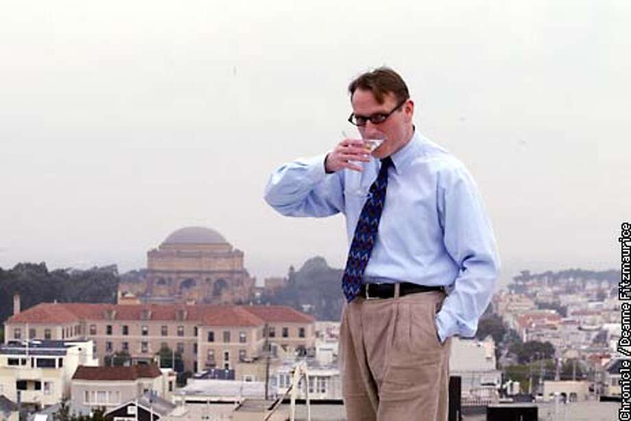 Hank Donat drinks a martini he made for the photo shoot. He started a website called mistersf.com about San Francisco. He is on a rooftop of a friends' home in Pacific Heights.  CHRONICLE PHOTO BY DEANNE FITZMAURICE Photo: DEANNE FITZMAURICE