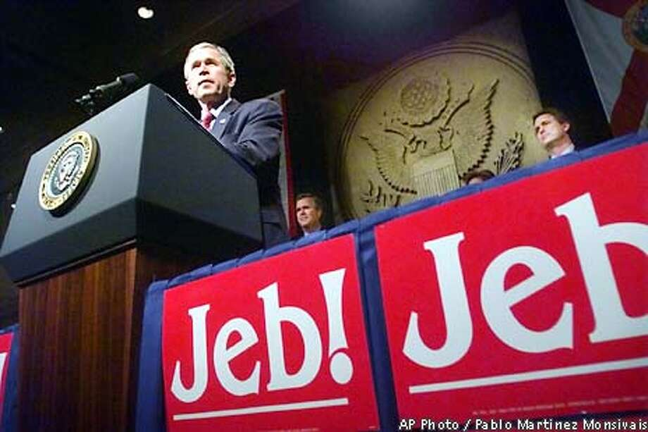 "President Bush address the audience at a fundraiser for his brother Florida Gov. Jeb Bush's campaign Wednesday, Jan. 9, 2002 in Washington. Standing in back are Gov. Jeb Bush and brother Marvin Bush, right. President Bush's public return to politics Wednesday was a family affair, a fund-raiser for his ""big little brother,"" and, as the White House described it, an election-year duty to democracy. (AP Photo/Pablo Martinez Monsivais) Photo: PABLO MARTINEZ MONSIVAIS"