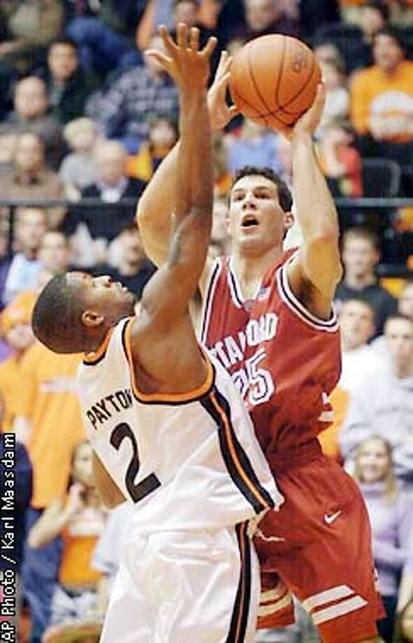Stanford's Tony Giovacchini puts up a shot over Oregon State guard Brandon Payton during the first half Thursday, Jan. 10, 2002, at Gill Coliseum in Corvallis, Ore. (AP Photo/Corvallis Gazette-Times, Karl Maasdam) Photo: KARL MAASDAM