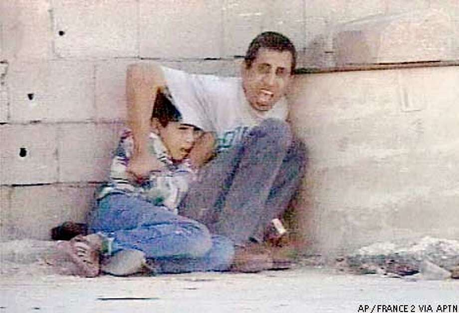 FILE--In this image from video, Jamal Aldura shouts towards the camera as he protects his 12-year-old son Mohammed Aldura, as they shelter from crossfire Saturday, Sept. 30, 2000, near Netzarim Jewish settlement in the Gaza Strip. Moments later the boy slumped to the ground fatally hit, and his father, gravely wounded, lost consciousness. Reversing itself, Maj. Gen. Yomtov Samia, commander of Israeli forces in the Gaza Strip, said at a news conference in Tel Aviv Monday Nov. 27, 2000, that Palestinian gunmen, not Israeli soldiers, probably killed Mohammed Aldura. (AP Photo/FRANCE 2 VIA APTN) **TV OUT, FRANCE OUT, ** Photo: KENDRA LUCK