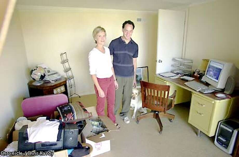 LEANNE MOS AND HER HUSBAND JAKE IN THEIR REMODELED HOME. THEY HAD TO LIVE IN THE BASEMENT DURING THE REMODEL. HERE THEY ARE IN THE BASEMENT THEY LIVED IN, NOW USED AS AN OFFICE.  -----CHRONICLE PHOTO BY CHRIS HARDY Photo: Chris Hardy