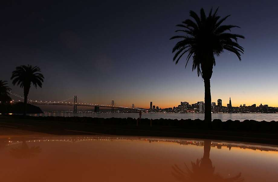 The setting sun over the shimmering skyline of San Francisco, Ca. on Saturday December 17, 2011. Photo: Michael Macor, The Chronicle