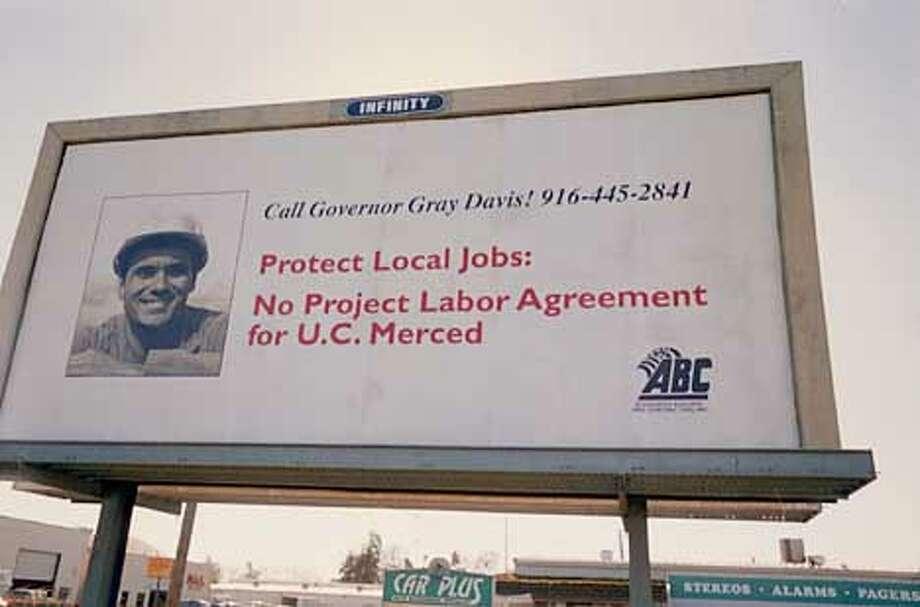 Billboards in the Merced area oppose UC Merced's proposal to use a project labor agreement during construction. The pact would set hours and working conditions for workers building the new campus