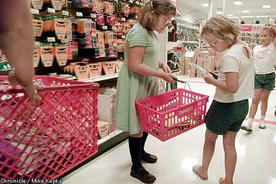 Catherine Messman, 10, and her sister Laura Messman, 8, of Walnut Creek check to make sure the have all the right back to school supplies while shopping at Target in Walnut Creek. BY MIKE KEPKA/THE CHRONICLE Photo: MIKE KEPKA