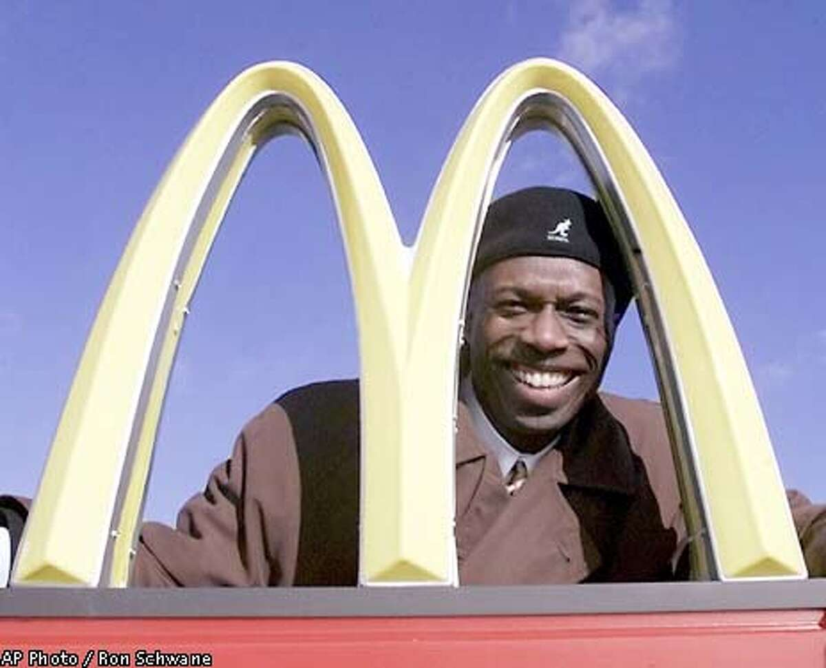 SPECIAL TO THE SAN FRANCISCO CRONICLE-- Herb Washington poses for a portrait outside his McDonalds restaraunt in Niles, Ohio, Thursday, Jan. 3, 2002. (AP Photo/Ron Schwane)