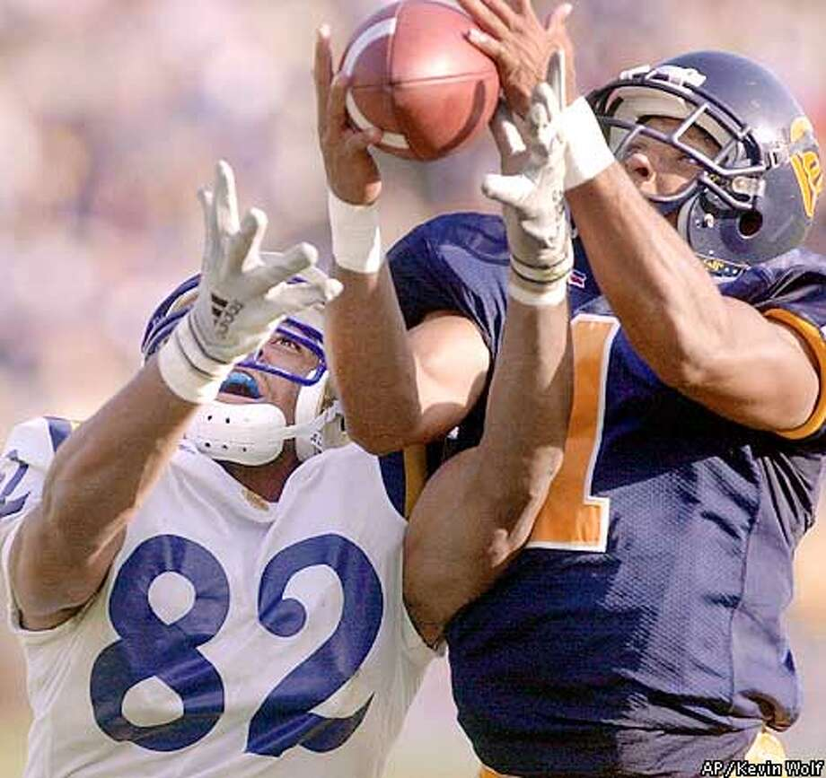 California's Jemeel Powell (1) intercepts a pass intended for UCLA's Brian Poli-Dixon (82) to win the game in overtime Saturday, Oct. 14, 2000, in Berkeley, Calif. California won 46-38 when UCLA failed to score on the play in its third overtime possession. (AP Photo/Kevin Wolf) Photo: KEVIN WOLF