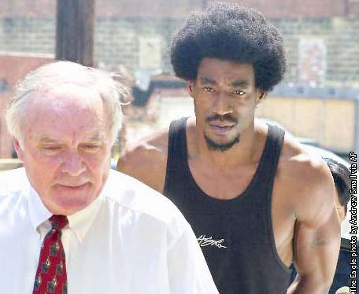 Golden State Warriors' Chris Porter, at right, is led into the Houston County Jail in Dothan, Ala., Friday, Aug. 24, 2001, by his attorney Terry Bullard, left, and a Dothan police officer, walking behind Porter. A Dothan police spokeswoman says Porter was arrested early Friday after he was stopped on a traffic violation in Dothan, Ala., near his hometown. Police allegedly found two small plastic baggies, one containing cocaine and the other marijuana, in the vehicle. (AP Photo/The Eagle, Andrew Small)