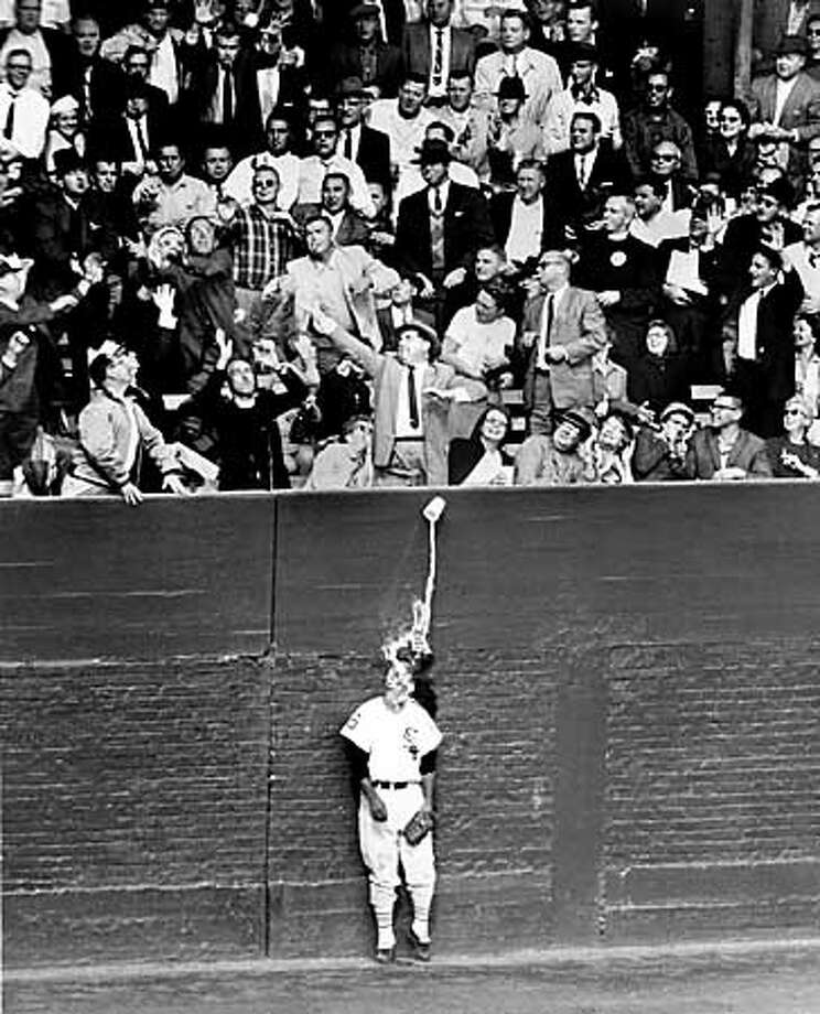 FILE - Chicago White Sox left fielder Al Smith is doused with the remnants from a paper drinking cup in the fifth inning of a World Series game at Comiskey Park, Oct. 2, 1959 against the Los Angeles Dodgers. Smith died Thursday at St. Margaret Mercy Hospital in Hammond, Ind., according to the team. His death followed a brief illness, the White Sox said. (AP Photo/Chicago Tribune, Ray Gora) Photo: RAY GORA