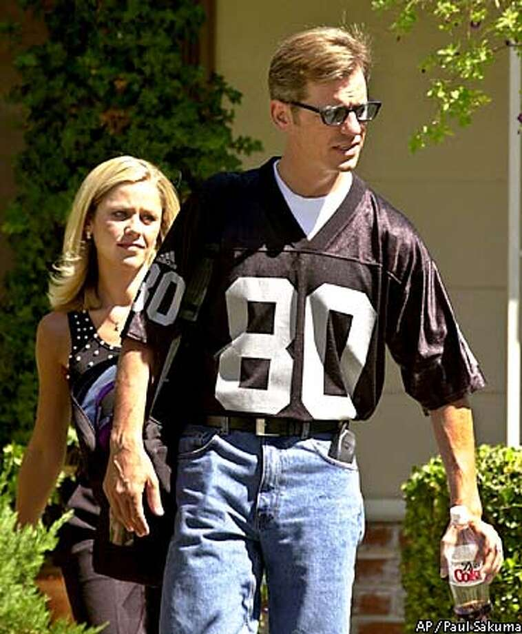 Chad Condit and his sister, Cadee Condit leave their father, Rep. Gary Condit, D-Calif., home in Ceres, Calif., Tuesday, Aug. 28, 2001. Gary Condit's two adult children resigned from California Gov. Gray Davis' office Tuesday, one day after the governor joined those criticizing their father in the case of missing intern Chandra Levy. (AP Photo/Paul Sakuma) Photo: PAUL SAKUMA