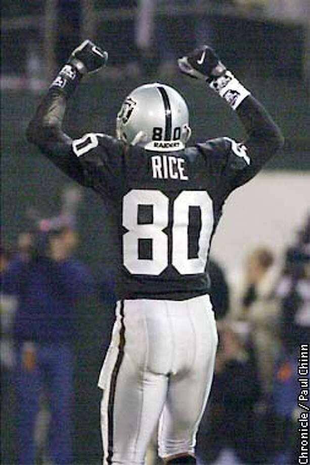 Jerry Rice celebrates another brilliant reception in the third quarter. The Oakland Raiders take on the New York Jets on Saturday, January 12, 2002 at Network Associates Coliseum. Paul Chinn/The Chronicle Photo: Paul Chinn