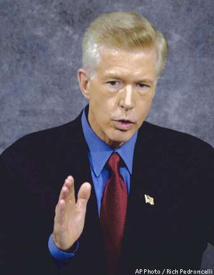 California Gov. Gray Davis gestures as he delivers his address at the Capitol in Sacramento, Calif., Tuesday, Jan. 8, 2002. Davis said said his budget proposal will not include a tax increase to close the projected $12 billioin budget deficit.(AP Photo/Rich Pedroncelli) Photo: RICH PEDRONCELLI