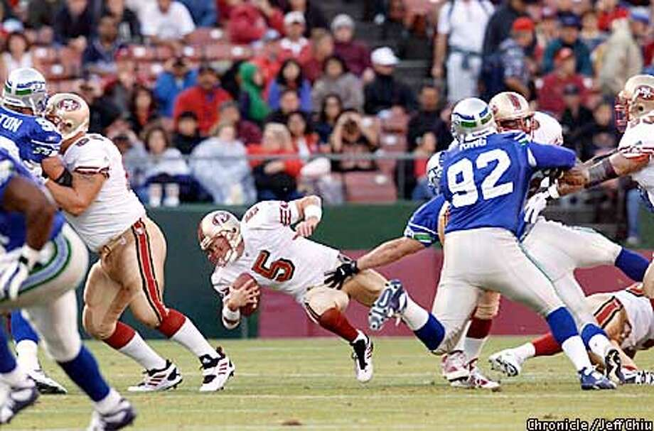Jeff Garcia is sacked in the first quarter by Levon Kirkland as the 49ers host the Seattle Seahawks in a preseason game on Saturday night at 3Com Park. Photo by Jeff Chiu / The Chronicle. Photo: Jeff Chiu