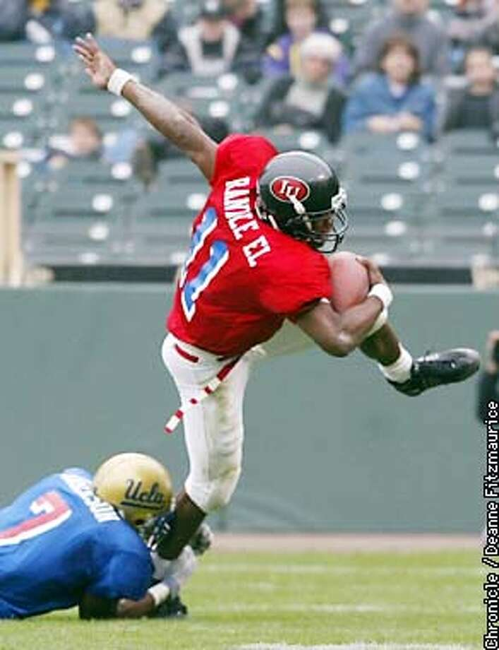 East Quarterback Antwaan Randle struggles to keep his balance against Marques Anderson. The West wins in the East West Shrine Game at Pacific Bell Park in San Francisco.  CHRONICLE PHOTO BY DEANNE FITZMAURICE Photo: DEANNE FITZMAURICE