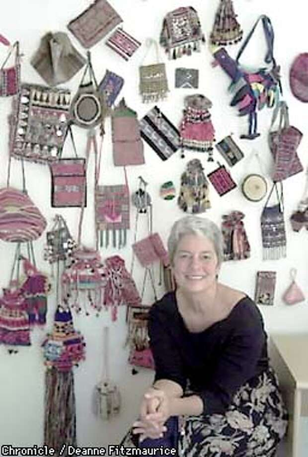 Paola Gianturco, photographer and writer, sits with her collection of small purses from around the world. She has photographed women and their crafts around the world. CHRONICLE PHOTO BY DEANNE FITZMAURICE