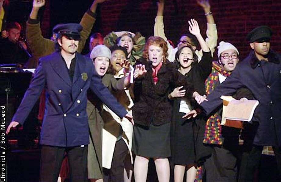 """LIGHTS14d-C-09JAN02-DD-BM  dress rehearsal of THE LIGHTS at ODC. the cast in a group, gesturing and shouting behind a """"police line"""".  Chronicle photo by Bob Mcleod Photo: BOB MCLEOD"""
