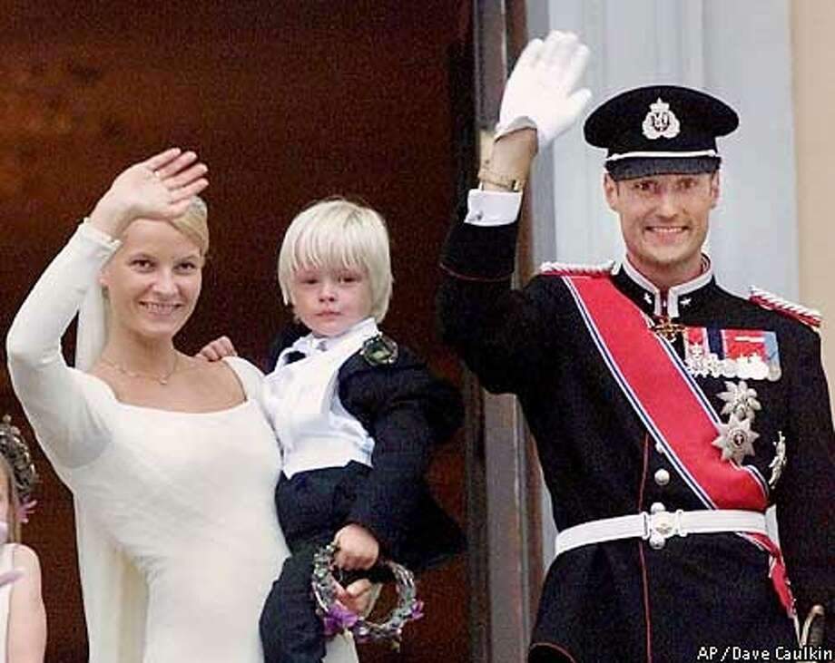 Norway's Crown Prince Haakon and his bride Crown Princess Mette-Marit, wave from the balcony of the Royal Palace in Oslo after their wedding ceremony Saturday Aug. 25, 2001. The Crown Princess is holding her four-year-old son Marius. (AP Photo/Dave Caulkin) Photo: DAVE CAULKIN