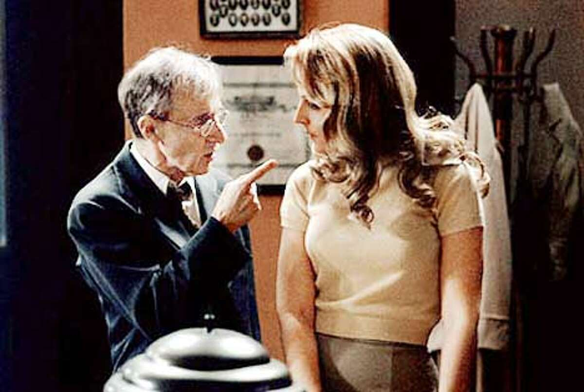 Woody Allen plays an insurance detective under a spell and Helen Hunt is a woman he kisses in