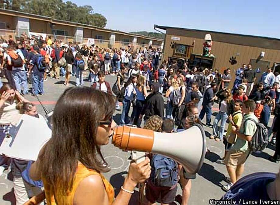 Asst Principle Cynthia Rapaido uses a bull horn to make anouncements during luch break at San Mateo High Students returned to their beloved campus monday after it was abruptly closed in May when architects preparring to renovate deemed it seismically unsafe. School reopened after a record 83 day construction period monday. BY LANCE IVERSEN/SAN FRANCISCO CHRONICLE Photo: LANCE IVERSEN