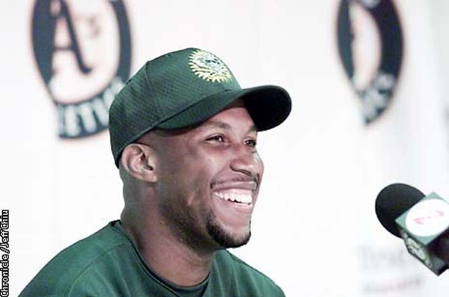 Newly acquired outfielder for the Oakland A's Jermaine Dye meets with the media at a press conference before the A's play the Minnesota Twins on Wednesday in Oakland. Photo by Jeff Chiu / The Chronicle. Photo: Jeff Chiu