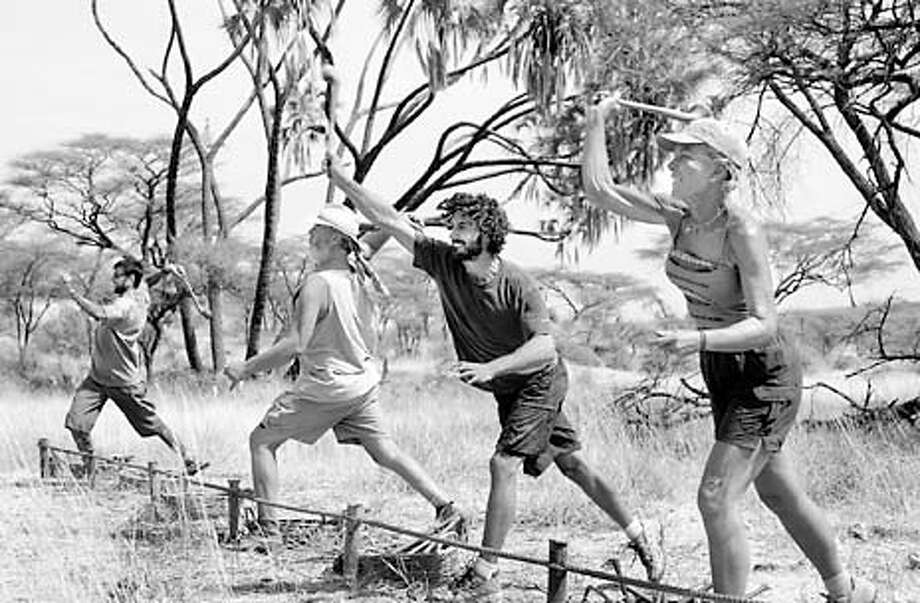 """CAPTION: On the eleventh episode of , contestants, from left, Lex van den Berghe, Tom Buchanan, Ethan Zohn and Kim Johnson, hurl traditional African throwing sticks during the """"Pot Shots 2"""" immunity challenge. Kim Powers and Teresa Cooper also competed in the challenge.  Photo: Monty Brinton/CBS  COPYRIGHT: �2001 CBS Worldwide Inc. All Right Reserved. This image may not be sold, distributed, stored or archived by any organization, agency or person. This image is for editorial use only, in North America only (United States of America, Canada, Mexico and Caribbean Islands). Editorial publication is not permitted after January 31, 2002. For usage of this image outside the above terms and conditions, please contact CBS via email at: cbsphotoarchive@cbs.com or via fax at 212/975-3338. Photo: MONTY BRINTON"""