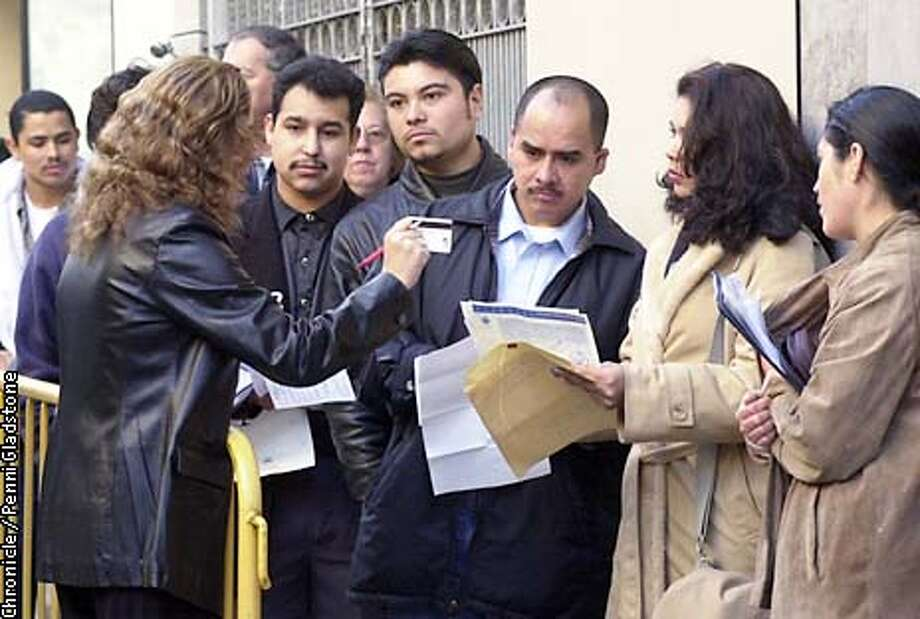 Myriam Rosiles makes sure papers are in order before letting applicants upstairs. at left is Antonio Zarafe, Alex Amador, Andres Garcia, Rosa Chavarin and Josefina Roldan. hundreds lined up to get a Mexican ID card. PHOTOGRAPHY BY PENNI GLADSTONE Photo: PENNI GLADSTONE