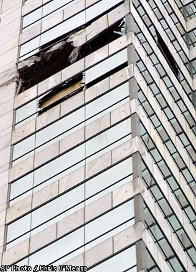 A gaping hole in the side of the Bank of America building is seen Sunday morning, Jan. 6, 2002, in Tampa, Fla., after a 15-year-old student pilot crashed a Cessna 172R into it Saturday. Officials said the boy was flying without permission. (AP Photo/Chris O'Meara) Photo: CHRIS O'MEARA