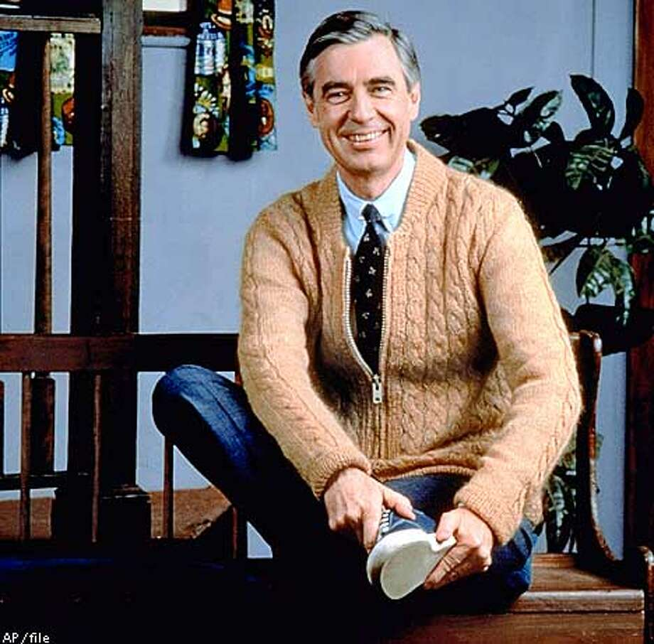 Fred Rogers poses on the Pittsburgh set of his television show ' Neighborhood, in this 1996 publicity photo. Rogers' new book, Dear : Does It Ever Rain in Your Neighborhood?, is a treasury of letters from young viewers, and Rogers' responses. (AP Photo/pool)