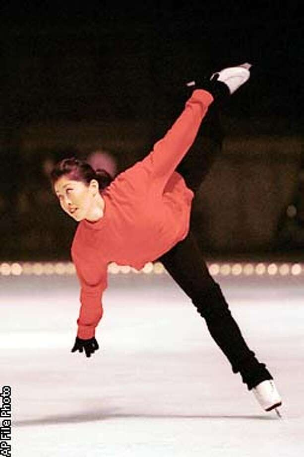 KRISTI10-C-DD  FILE--Kristi Yamaguchi practices her routine on the ice of the Oakland Coliseum in Oakland, Calif., Friday, Sept. 17, 1999. Yamaguchi will join five other female Olympic gold medalists Saturday for A Golden Moment, an event dedicated to help support the fight against breast cancer. (AP Photo/Mervyn's California, Peter Lennihan) Photo: PETER LENNIHAN