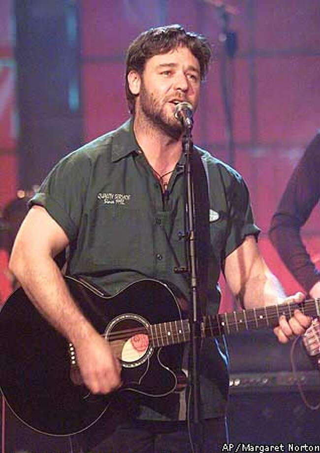 "Russell Crowe sings during a taping of the ""The Tonight Show with Jay Leno,"" Thursday, Aug. 16, 2001, in Burbank, Calif. (AP Photo/NBC, Margaret Norton)"
