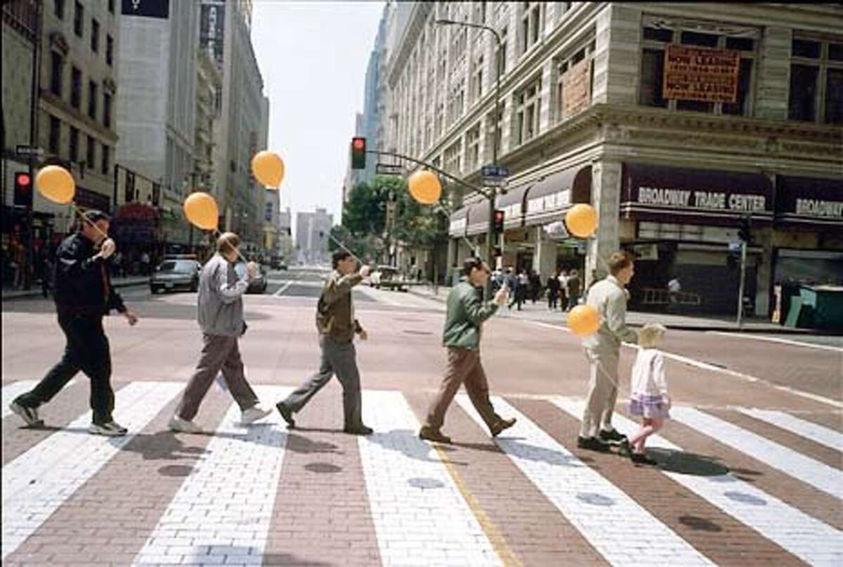 """There's also a picture of a bunch of guys recreating the Abbey Road album cover. It's Sean Penn, Dakota Fanning and some other actors from the movie. These are jpegs for grandaddy10, a potential centerpiece feature on the making of the """"I Am Sam"""" sountrack (all Beatles covers by contemporary artists). HANDOUT."""