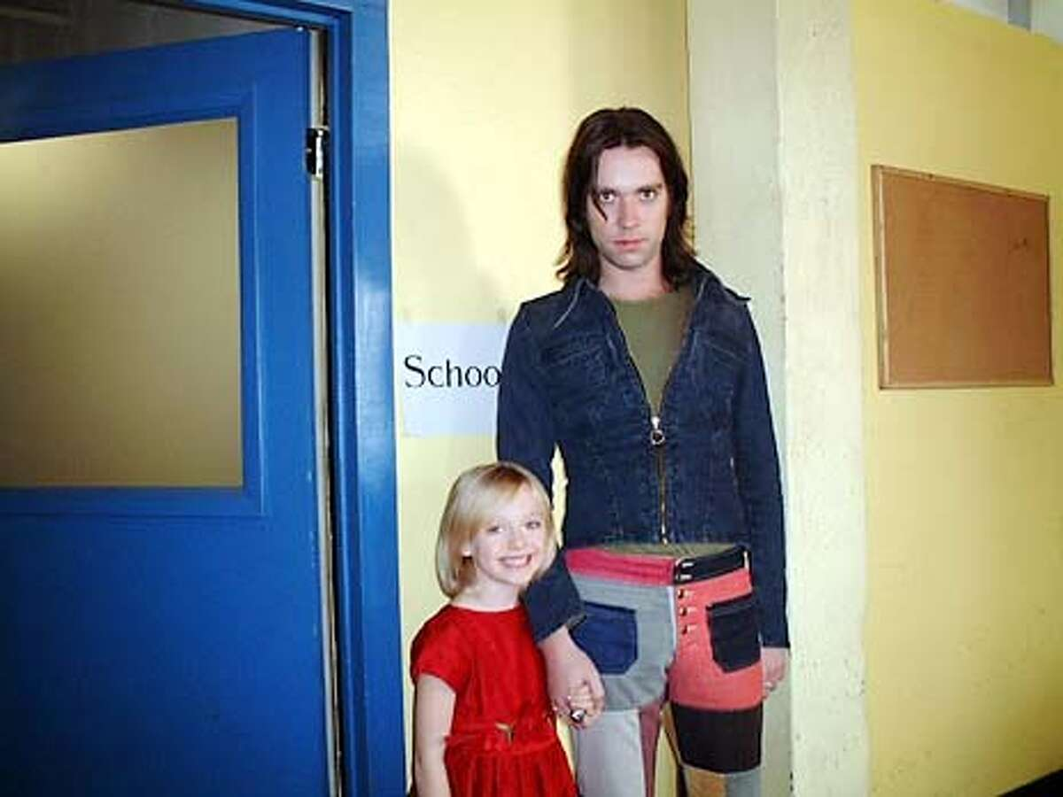 """The guy with the young girl is Rufus Wainwright with Dakota Fanning, who plays the little girl in the movie. These are jpegs for grandaddy10, a potential centerpiece feature on the making of the """"I Am Sam"""" sountrack (all Beatles covers by contemporary artists). HANDOUT."""