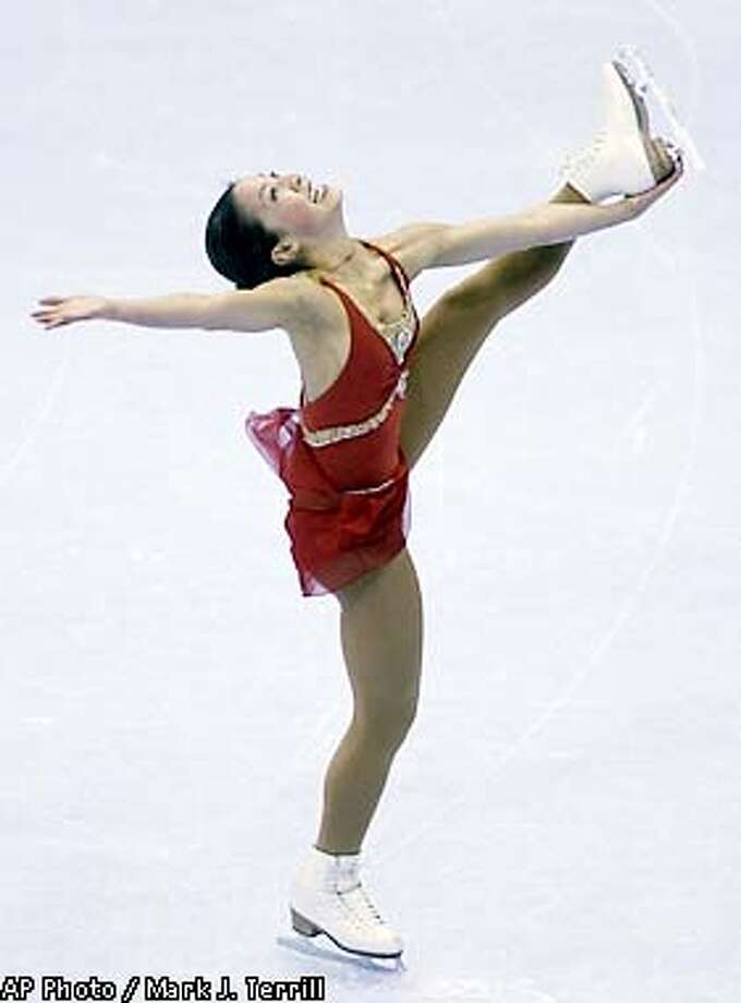 Michelle Kwan spins during her free skate at the U.S. Figure Skating Championships Saturday, Jan. 12, 2002, in Los Angeles. (AP Photo/Mark J. Terrill) Photo: MARK J. TERRILL