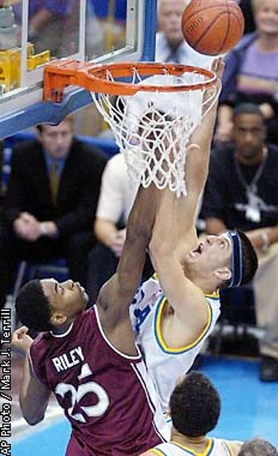 UCLA's Jason Kapono, right, shoots over Washington State's Milton Riley during the first half Sunday, Jan. 6, 2002, in Los Angeles. UCLA won 81-69. (AP Photo/Mark J. Terrill) Photo: MARK J. TERRILL