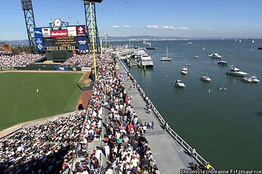 The view from one of the luxury boxes in Pacific Bell Park encompasses McCovey cove with all the boats that come in during the game, the East Bay in addition to the field. In the foreground is the Promenade where people stroll along during the game.  CHRONICLE PHOTO BY DEANNE FITZMAURICE Photo: DEANNE FITZMAURICE
