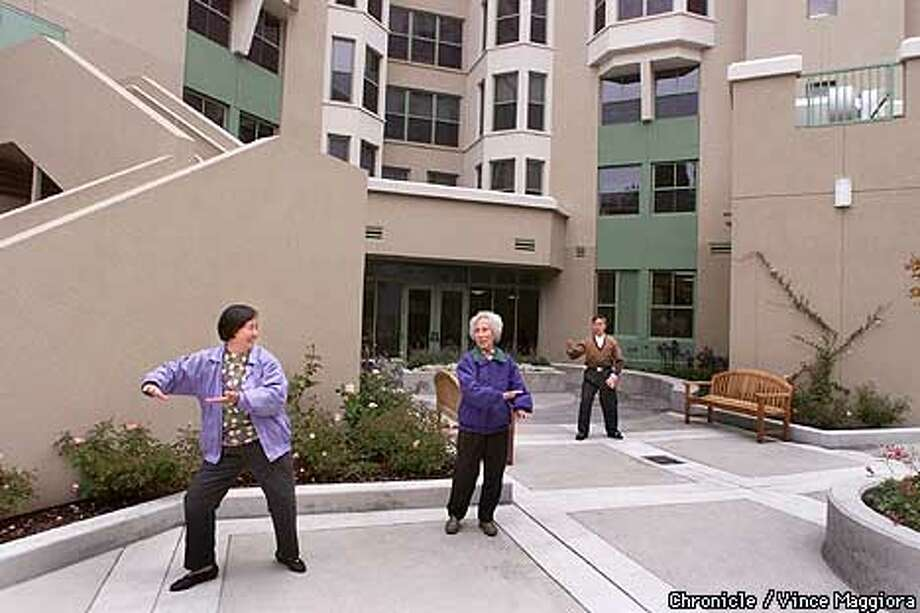 L to R Cai Yu Liu , Shun Yee Tam and Long Wu doing their morning exercise at The new Presentation Senior Community the first of affordable housing five after the SF voters approved a $100 million bond for affordable housing.  by Vince Maggiora Photo: VINCE MAGGIORA