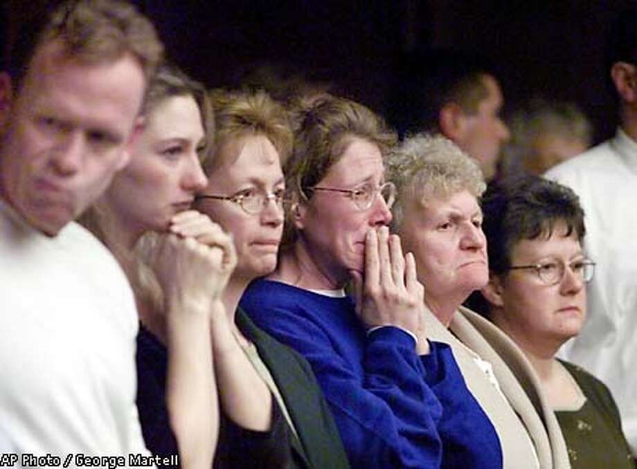 ADDS THAT PEOPLE ARE JUNTA'S FAMILY AND FRIENDS - Family and friends of Thomas Junta listen as a verdict of guilty of involuntary manslaughter is read during Junta's trial in Cambridge, Mass., Friday, Jan. 11, 2002. Junta was on trial for the beating death of Michael Costin following their sons' hockey practice in July 2000. Junta claimed he killed Costin, 40, in self-defense after they argued over rough play during the practice. (AP Photo/Pool, George Martell) Photo: GEORGE MARTELL