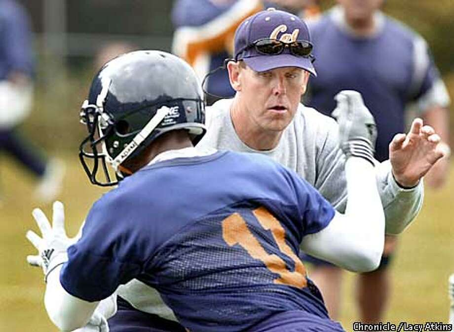 Head Coach Tom Holmoe blocks player Derek Swafford during practise Sunday Aug.12,01, in Berkeley. Photo By Lacy Atkins/SanFrancisco Chronicle Photo: Lacy Atkins
