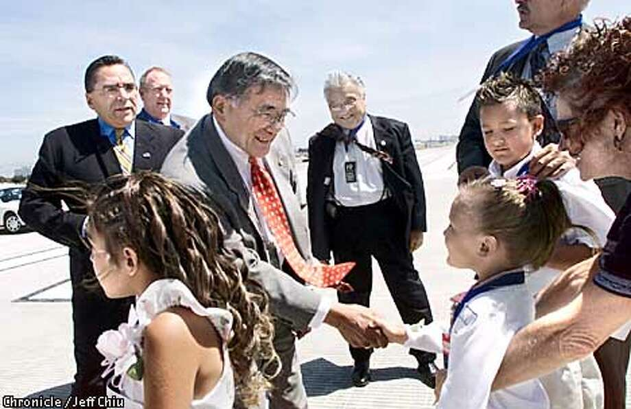 Former mayor of San Jose and current U.S. Secretary of Transportation Norman Mineta greets children at a ceremony for the opening of a new runway at the San Jose International Airport on Monday afternoon, along with San Jose mayor Ron Gonzales, left. Photo by Jeff Chiu / The Chronicle. Photo: Jeff Chiu
