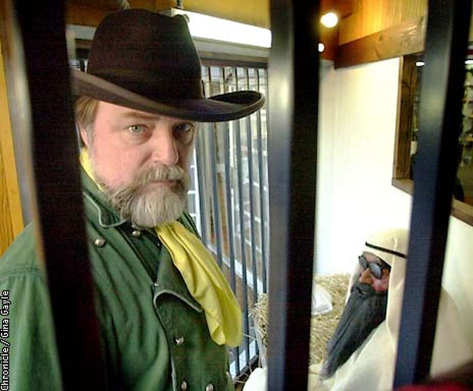 Bill Knudsen, owner of Golden Gate Western Wear, stands in the window display he made of Osama bin laden imprisoned in a jail cell awaiting death. Photo by Gina Gayle/The SF Chronicle. Photo: GINA GAYLE