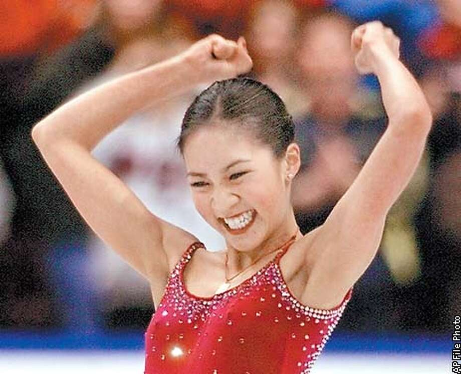 Michelle Kwan reacts after skating to a gold medal at the Championships in Vancouver, British Columbia, Saturday, March 24, 2001. (AP Photo/Jack Smith) Photo: JACK SMITH
